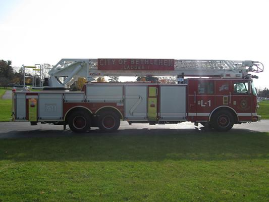 2009 Pierce Arrow XT - new aerial ladder truck - passenger side