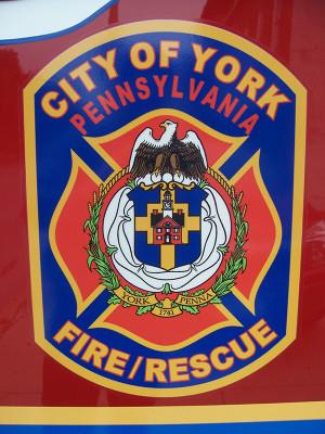 City of York Fire Department Maltese cross emblem on fire engine