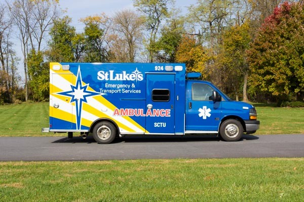 passenger side view 2016 Braun Chief XL Type III ambulance