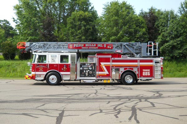 driver side view 2017 Pierce Enforcer Ascendant quint ladder truck
