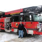 Warrior Run Area Fire Department Chief Doug Funk stands by the department's new $925,000 ladder truck.